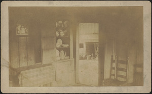 """A corner of the """"bar room"""" looking into the """"summer kitchen,"""" in the old Pillsbury house, Newburyport, Mass."""