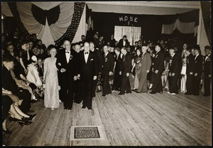 Chief of firedept. Dr. + Mrs. W. B Segur leading grand march. (The man on Segur's left is McEnelly leader of the orch.)