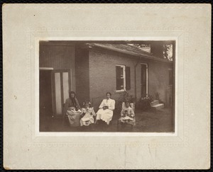 4 females sitting in front of Martha Mattoon's house
