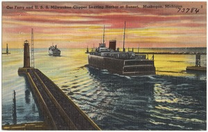 Car ferry and U. S. S. Milwaukee clipper leaving harbor at sunset, Muskegon, Michigan