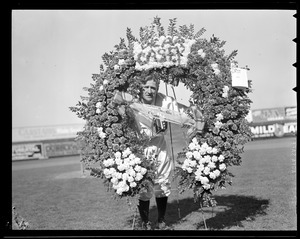 Casey Stengel with floral arrangement