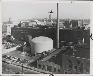 Aerial view of MIT nuclear reactor building (tank-like structure in picture above) and building to its right housing its laboratories, shots and offices