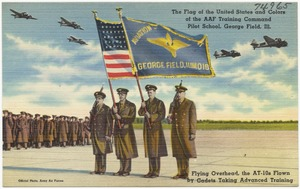 The flag of the United States and colors of the AAF Training Command Pilot School, George Field, Ill, flying overhead, the AT-10s flown by cadets taking advanced training