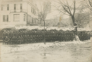 Soldiers posed in front of trucks possibly in France