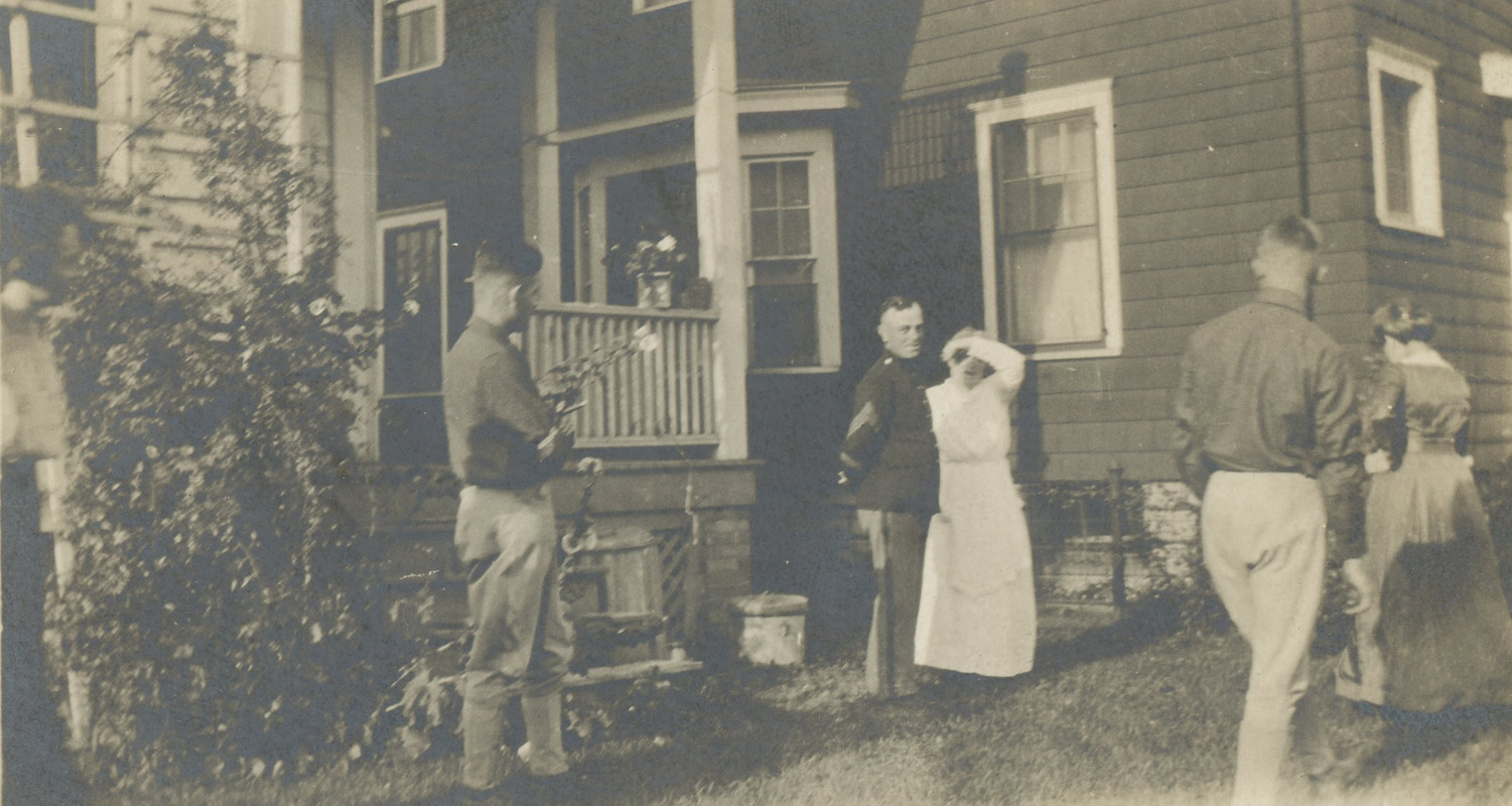 Soldiers and family members outside house