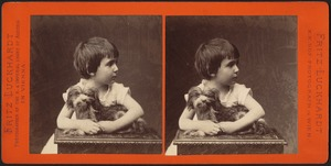 Small child posed with dog