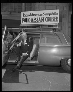 Dr. Albert B. Sabin speaking with a microphone in the Record American-Sunday Advertiser Polio Message Cruiser