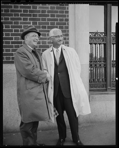 Dr. Albert B. Sabin (right) and Leo Dunphy, chapter chairman of the National Foundation shaking hands