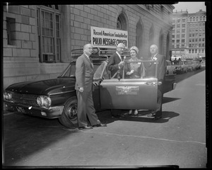 Dr. Albert B. Sabin (second from left) and three others posing with the Record American-Sunday Advertiser Polio Message Center Cruiser