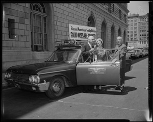 Dr. Albert B. Sabin (far left) and two others stand beside the Record American-Sunday Advertiser Polio Message Cruiser