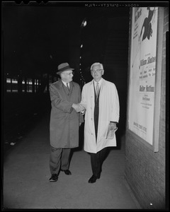 Dr. Albert B. Sabin (right) shakes hands with Leo Dunphy, chapter chairman of the National Foundation