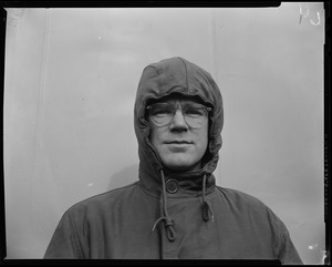 Man wearing a hood and glasses