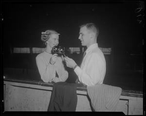 Barbara Ann Scott and a man, holding maracas