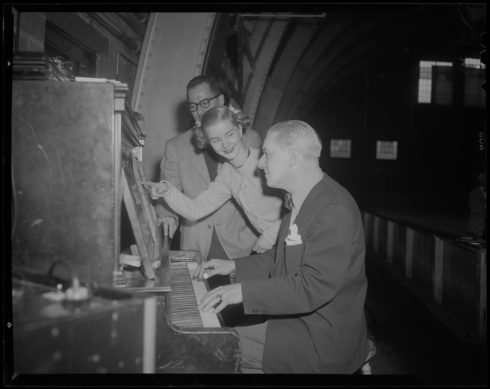 Barbara Ann Scott with two men, at the piano