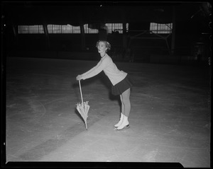 Barbara Ann Scott on skates, with umbrella pointed down