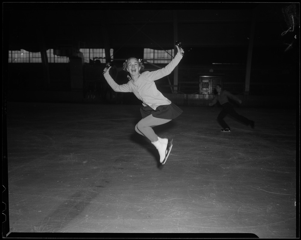 Barbara Ann Scott jumping in the air, with skates on