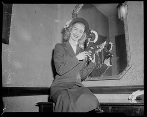 Barbara Ann Scott posing with toy horse