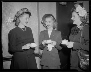 Barbara Ann Scott with two women in conversation and holding teacups