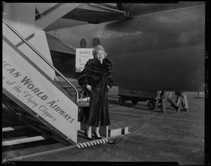 Zsa Zsa Gabor at the bottom of plane stairs