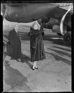 Zsa Zsa Gabor walking off plane stairs
