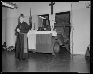 Archbishop Richard J. Cushing in front of a truck, turned altar