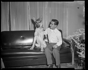 Tony DeSpirito sitting on a couch with a dog