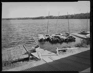 Damaged boat dock with boats