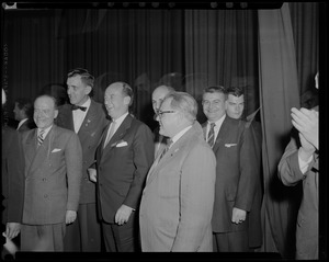 Adlai Stevenson and group of men, looking off camera