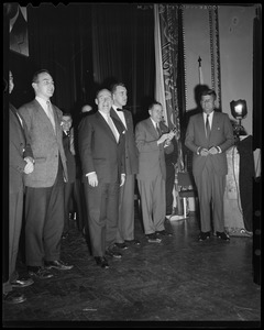 Adlai Stevenson on stage with his son Adlai Stevenson III (far left), John F. Kennedy (far right) and two others