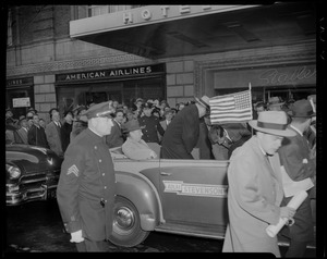 Adlai Stevenson in a convertible, driving by Statler Hotel