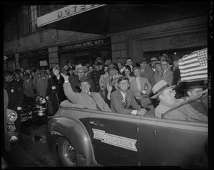 Adlai Stevenson waving in convertible with John Kennedy and others