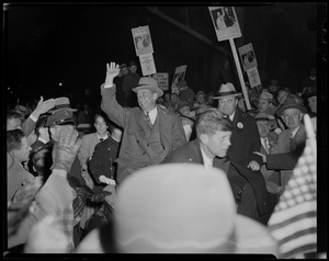 Adlai Stevenson waving to crowd from car with Paul Dever and John F. Kennedy