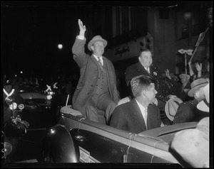 Adlai Stevenson and Paul Dever in convertible moving through parade
