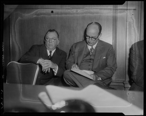 Adlai Stevenson and another man seated