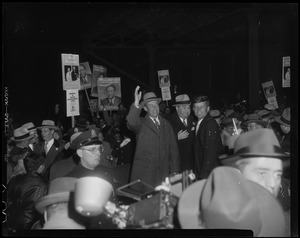 Adlai Stevenson waving to crowd, with Paul Dever and John F. Kennedy next to him