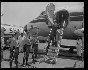 Adlai Stevenson walking off of Northeast Airlines airplane
