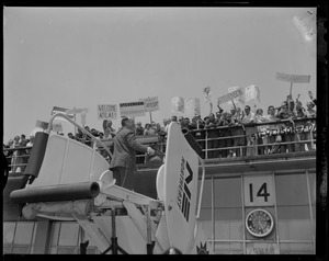 Adlai Stevenson on motorized staircase, addressing fans on top level