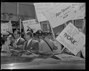 Adlai Stevenson getting ready to enter the car, surrounded by supporters