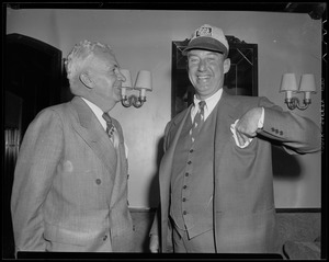 Adlai Stevenson and another man standing in a room