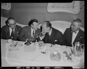 Adlai Stevenson and three others seated at a dining table