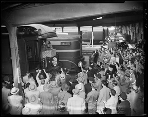 "Adlai Stevenson addressing a crowd from the back of ""Adlai Stevenson Special"" train in a railroad station"