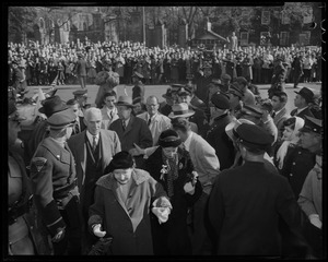 Adlai Stevenson and several others walking through a crowd