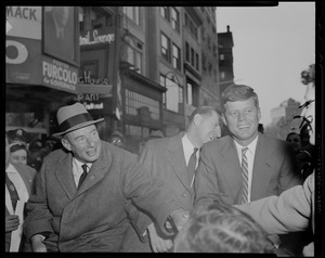 Adlai Stevenson and John F. Kennedy in car greeting supporters