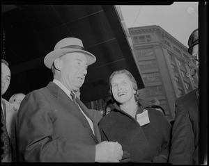 Adlai Stevenson and a woman standing outside