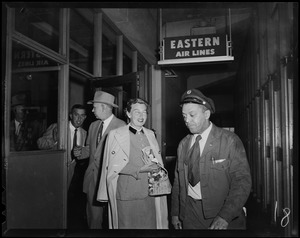 Mrs. Arthur Godfrey walking out of the Eastern Air Lines terminal
