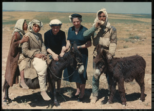Helen Keller and Polly Thomson with Miniature Donkeys in the Middle East