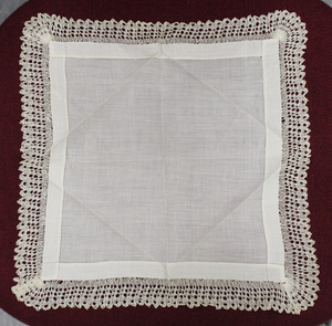 Napkin with lace edge tatting, made by Laura Bridgman