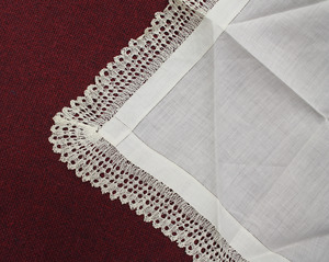 Napkin with lace edge tatting, made by Laura Bridgman (close-up)