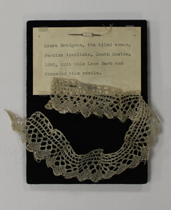 Threaded needle and strip of lace (barb), made by Laura Bridgman