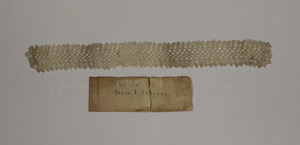 Strip of lace (tatting) with signature and price tag, made by Laura Bridgman